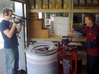 andy filtering wine with videographer sm.jpg